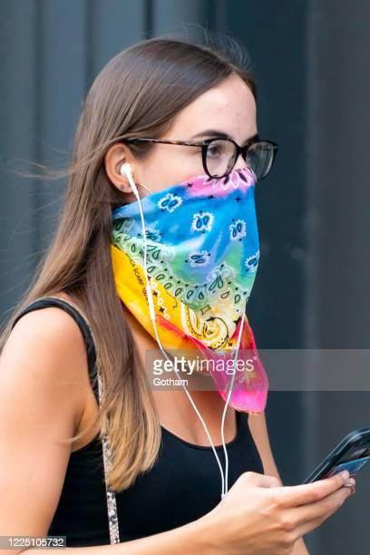 Woman is seen wearing a protective face mask during the coronavirus pandemic in the SoHo on May 15, 2020 in New York City.
