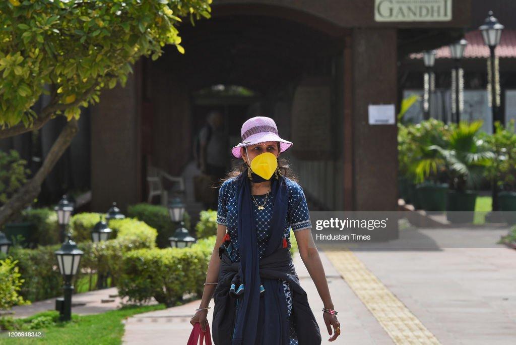 People Take Precautions Following Few Positive Cases Of Coronavirus, Cinema Halls, Schools To Remain Shut Till March 31 : News Photo