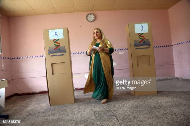 A woman is seen while going to cast her vote during the referendum September 25 2017 is a historic day for Kurdish people around the world as many...