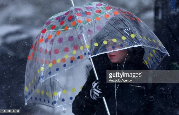 A woman is seen with an umbrella during a snowstorm in New York United States on January 04 2018