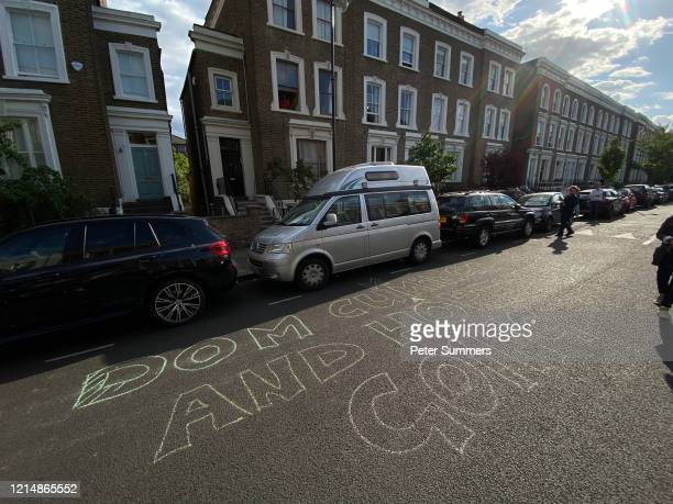 A woman is seen writing Dominic Cumings and Goings outside Dominic Cummings' house on May 24 2020 in London England On March 31st 2020 Downing Street...