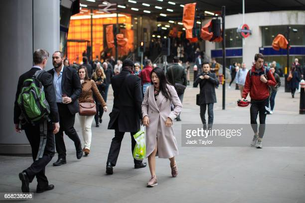 A woman is seen yawning as commuters leave Cannon Street Station on March 27 2017 in London England British Prime Minister Theresa May will trigger...