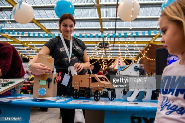 A woman is showing some paper robots to a little girl during the Bright Day Festival in Amsterdam on November 23rd 2019