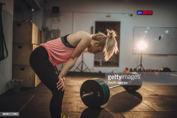 woman is tired of training - persistence stock pictures, royalty-free photos & images
