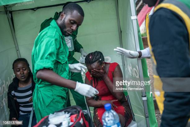 A woman is treated for her injuries after being rescued from the Dusit Hotel complex after being rescued on January 15 2018 in Nairobi Kenya A...