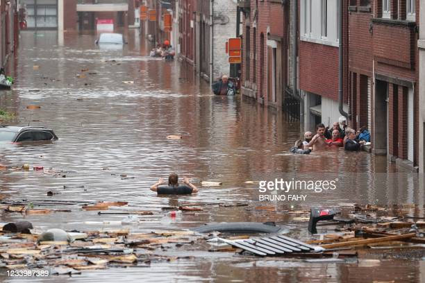 Woman is trying to move in a flooded street following heavy rains in Liege, on July 15, 2021. Illustration shows the scene in Liege after heavy...