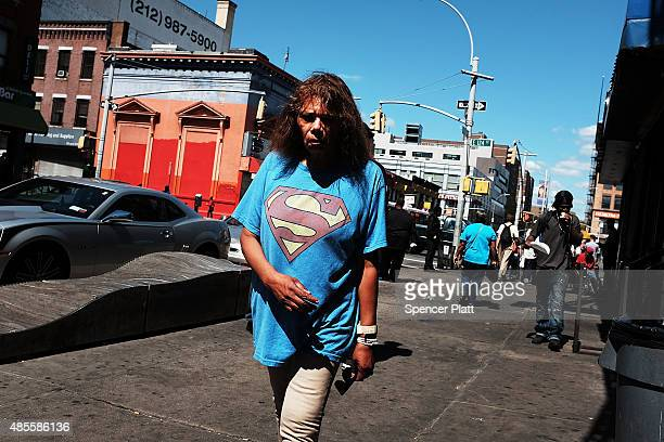 A woman is viewed in an area of East Harlem where K2 or 'Spice' a synthetic marijuana drug is often consumed on August 28 2015 in New York City New...