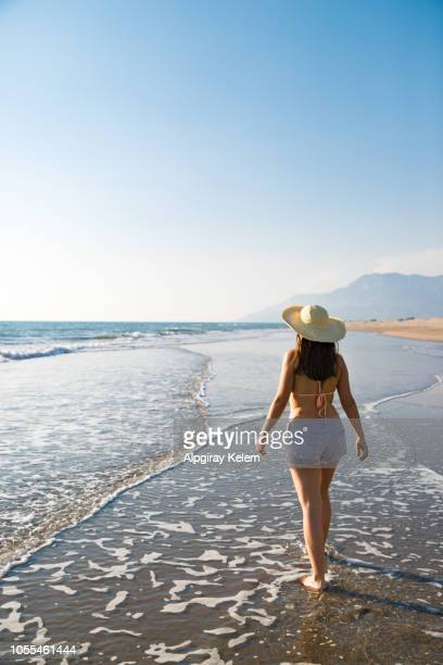 woman is walking to the sea - action movie stock pictures, royalty-free photos & images