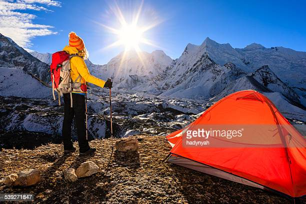 Woman is watching sunrise in Himalayas, Mount Everest National Park