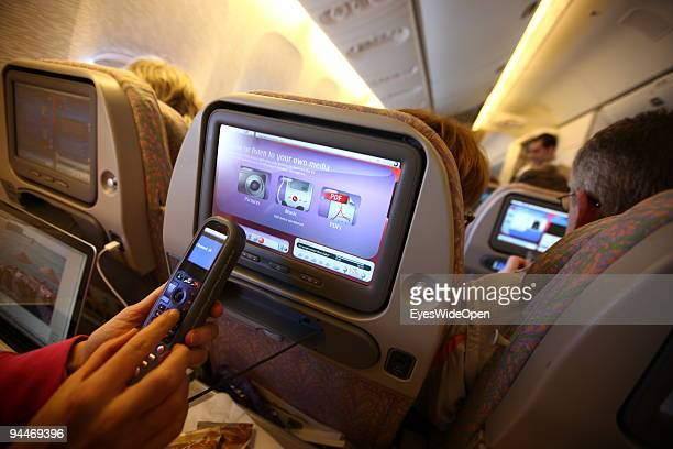 A woman is working an makes a telephone call on board of a Emirates Airline passenger jet on December 08 2009 in Trivandrum India Since some month...