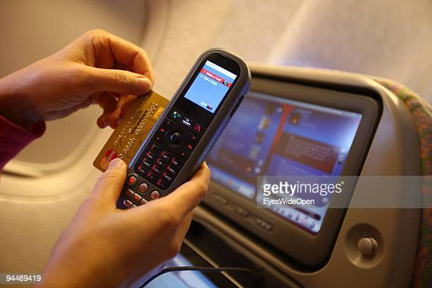 A woman is working an makes a telephone call paid by credit card on board of a Emirates Airline passenger jet on December 08 2009 in Trivandrum India...