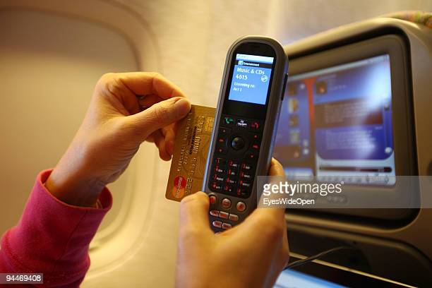 A woman is working an makes a telephone call pays by credit card on board of a Emirates Airline passenger jet on December 08 2009 in Trivandrum India...
