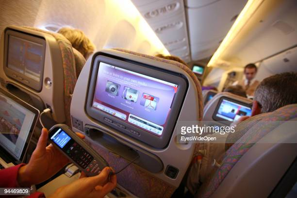 A woman is working with a notebook and makes a telephone call on board of a Emirates Airline passenger jet on December 08 2009 in Trivandrum India...