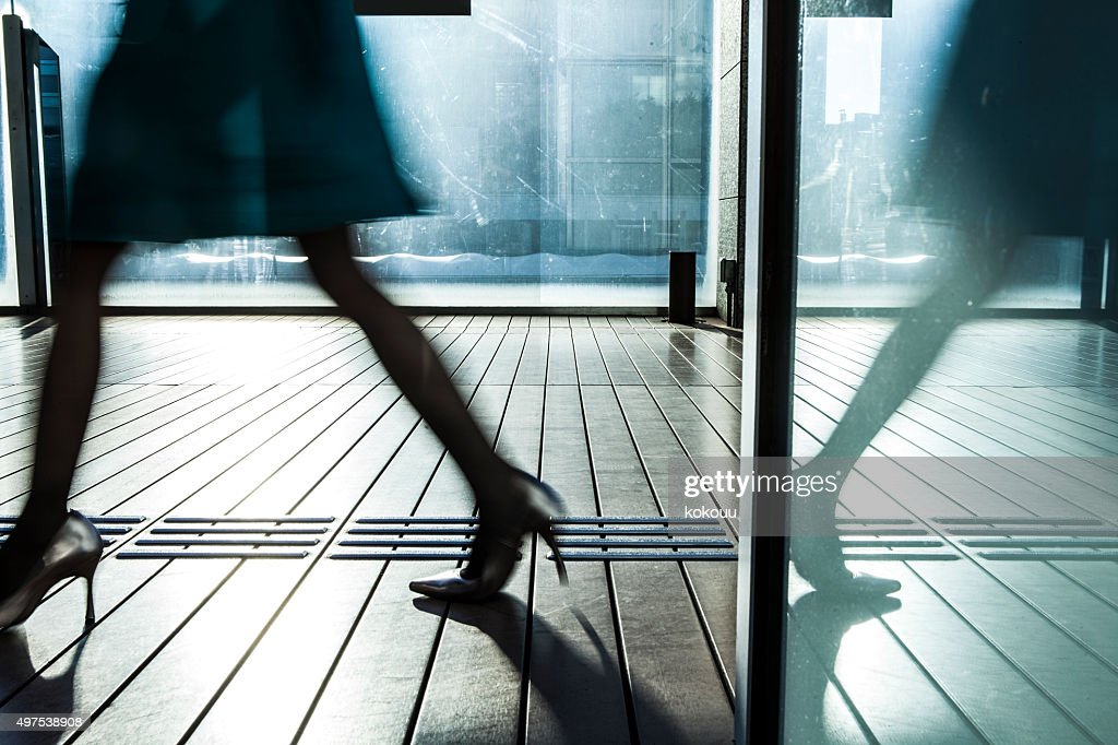 Woman it is glass door easy reflection : Stock Photo