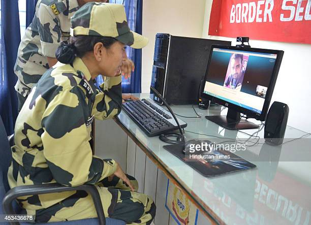 woman Jawan talks to her brother through video chat on the occasion of Raksha Bandhan at Khassa on August 10 2014 in Amritsar India The festival of...