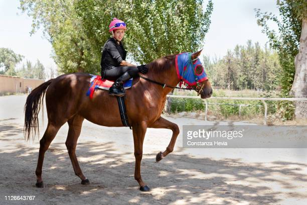 woman jockey riding a horse - riding boot stock pictures, royalty-free photos & images