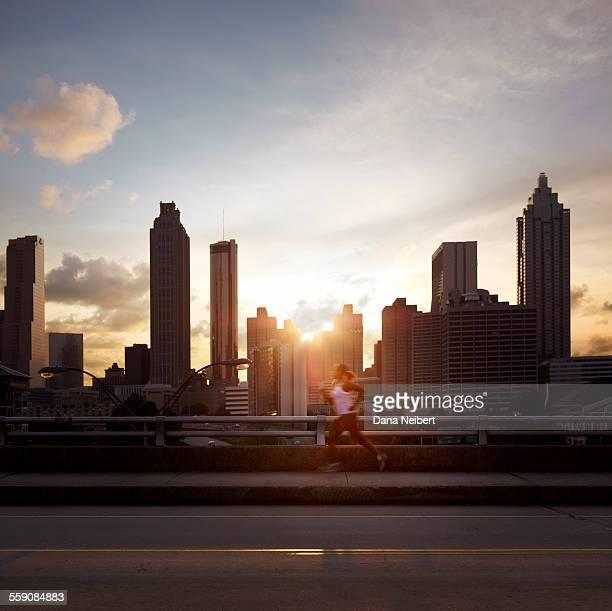 Woman jogging against the Atlanta sky line