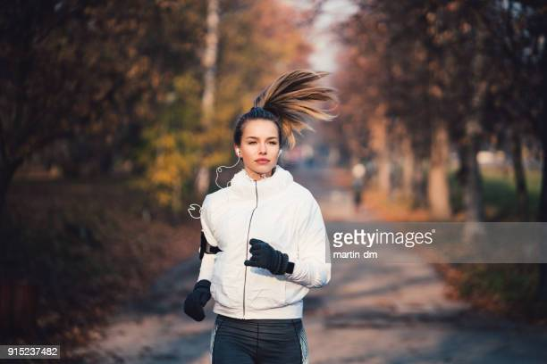 woman jogging among nature - sports glove stock pictures, royalty-free photos & images