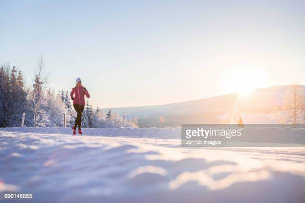 Woman jogging at winter