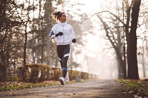 Woman jogging during winter morning 1086374508