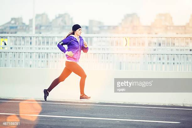 Woman jogging in a city.
