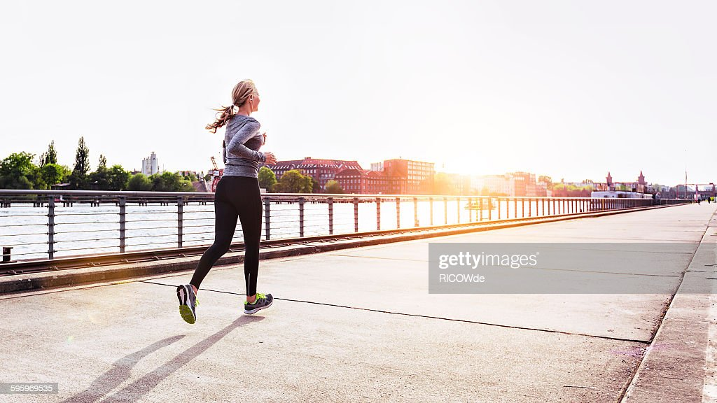 Woman jogging in Berlin city : Stock Photo