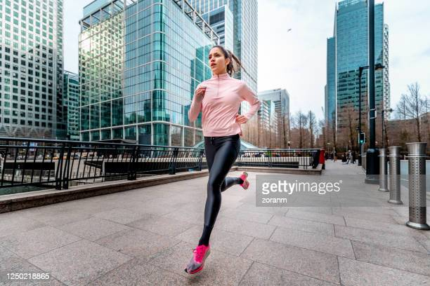 woman jogging in london - canal stock pictures, royalty-free photos & images