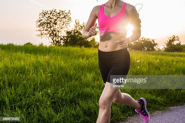 woman jogging in park - running shorts stock pictures, royalty-free photos & images