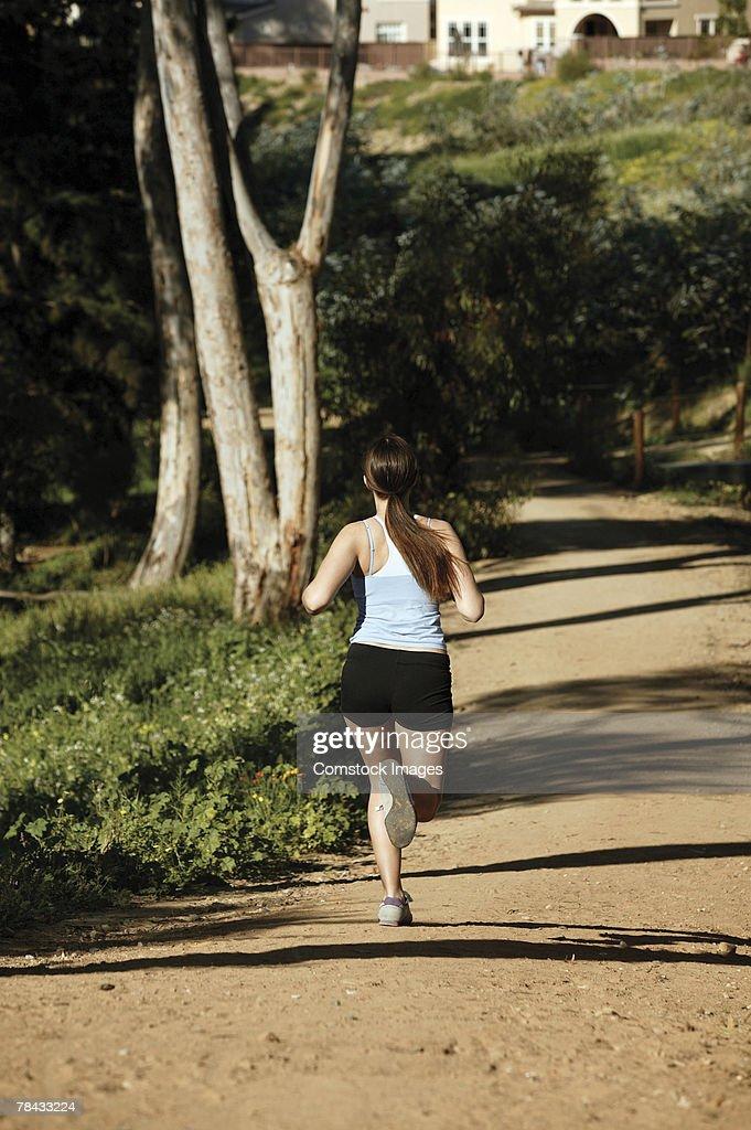 Woman jogging in park : Stockfoto
