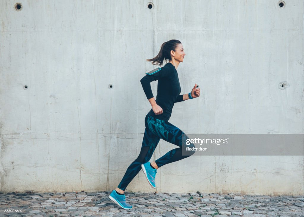 Woman jogging in the city : Stock Photo