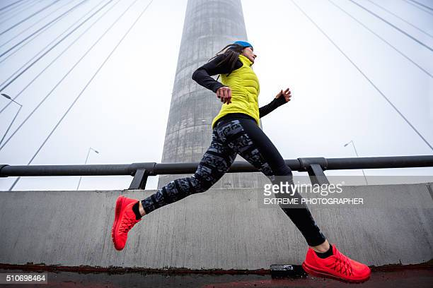 Woman jogging in the winter morning