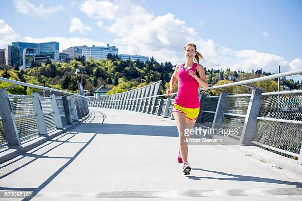 Woman jogging in urban area, Portland, Oregon, USA