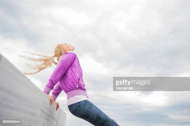 Woman jogging near sea