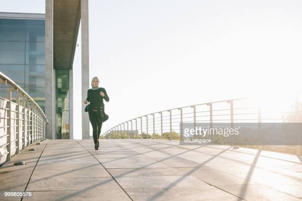 Woman jogging on a sunny evening.