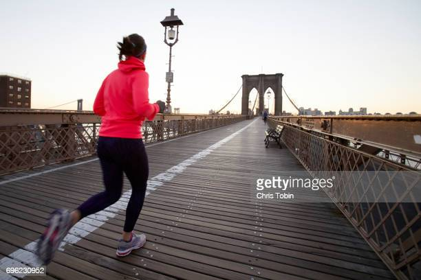 Woman jogging on Brooklyn Bridge