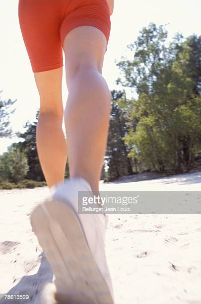 Woman jogging on pathway outdoors