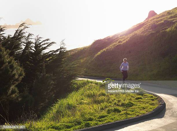 Woman jogging on winding road