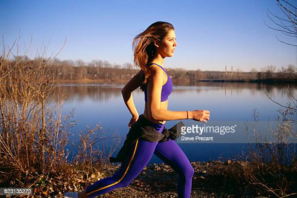 Woman Jogging Past Lake
