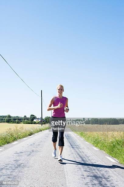A woman jogging Sweden.