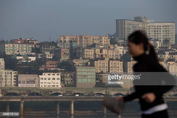 A woman jogs along the Han River past UN village in Seoul South Korea on Tuesday Sept 30 2014 South Korean President Park Geun Hyes success in...