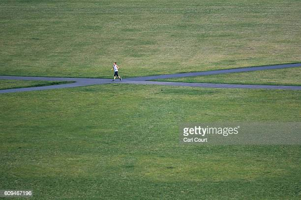 A woman jogs through Greenwich Park on September 21 2016 in London England Today marks final day of summer as the autumn equinox arrives on Thursday...