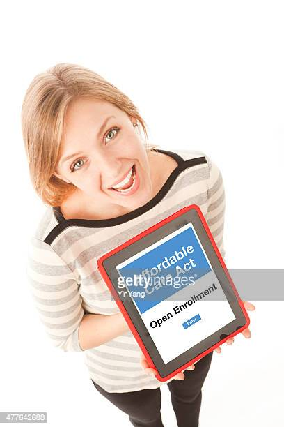 woman joining affordable care act obamacare open enrollment - open enrollment stock photos and pictures