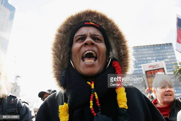 A woman joins in a chant as thousands of people take part in the NAIDOC march on July 6 2018 in Melbourne Australia The march marks the start of...