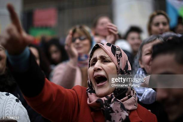 Woman joins in the singing and chanting at the Place De La Bourse in honour of the victims of yesterdays' terror attacks on March 23, 2016 in...