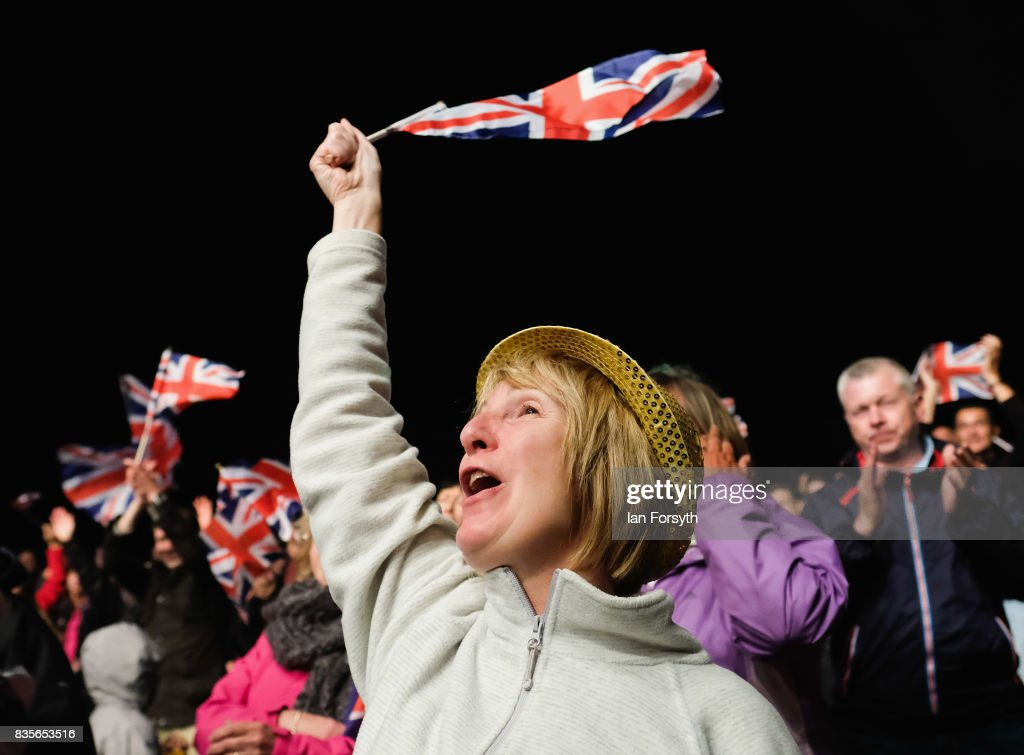 A woman joins thousands of spectators attending the annual Castle Howard Proms Spectacular concert held on the grounds of the Castle Howard estate on August 19, 2017 in York, England. The outdoor picnic concert celebrated the best of British with a rousing medley of traditional orchestral anthems from the London Gala Orchestra conducted by Stephen Ellery and special guest performances from Brit award winners Blake and soprano Joanne Forest.