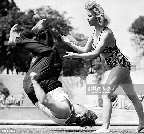 A woman judo instructor demonstrates how to flip a man on an LA high school teacher Los Angeles California June 3 1944