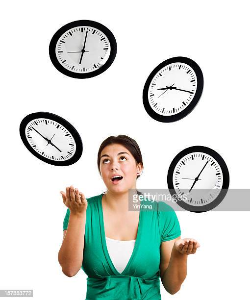 woman juggling clocks, balancing time management stress of planning, organization - time management stock photos and pictures