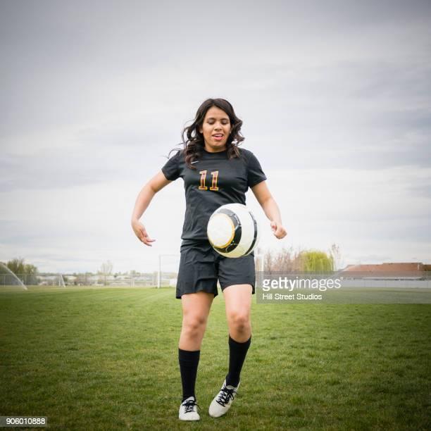 Woman juggling soccer ball