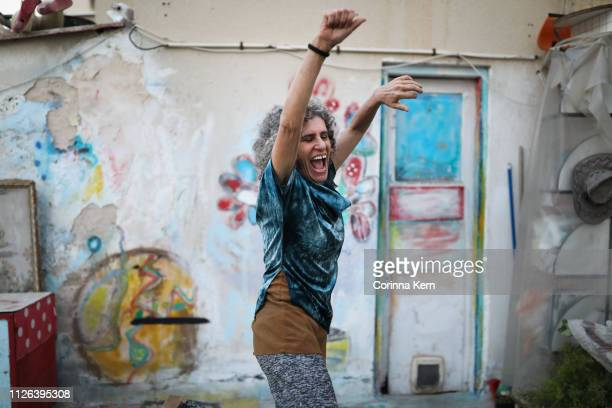 woman jumping and dancing - beautiful israeli women stock pictures, royalty-free photos & images