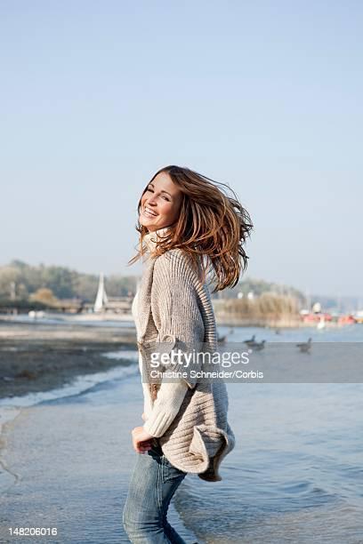 Woman jumping at lakeshore